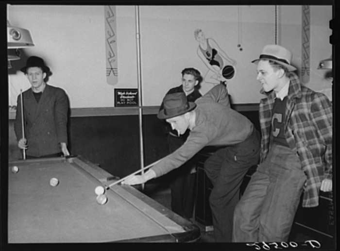 11. These high school students are from 1940. They are playing pool in Clinton, Indiana.