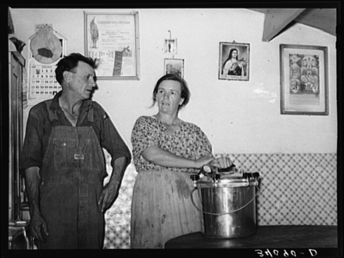 """9. """"Mr. and Mrs. Schoenfeldt, FSA (Farm Security Administration) clients, in Sheridan County, Kansas, with pressure cooker of which she is very proud."""""""