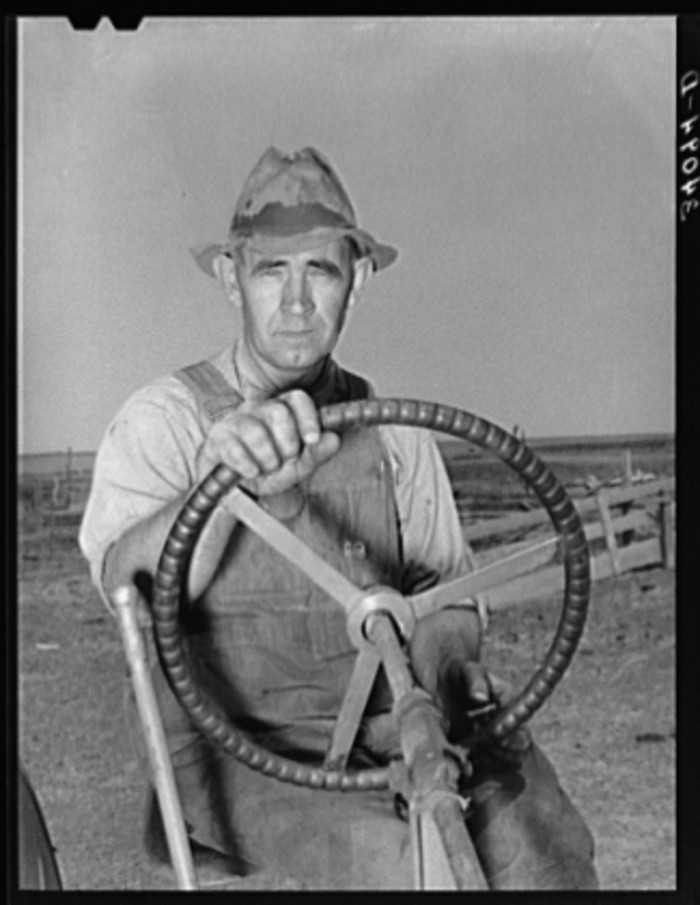 """16. """"Mr. Germeroth, FSA (Farm Security Administration) client, at wheel of tractor which he bought with FSA loan."""""""