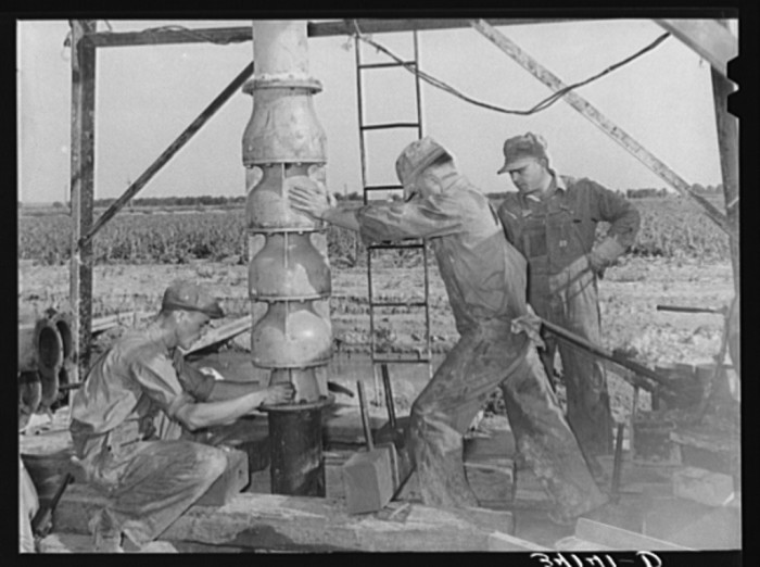 """4. """"Getting ready to put in the pumping part of the water well for irrigation purposes on a farm near Garden City, Kansas."""" (1939)"""