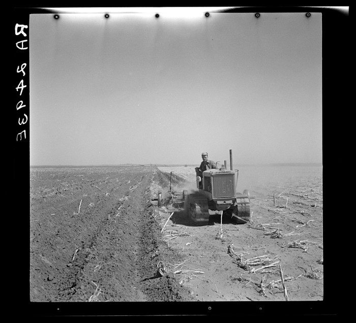 """7. """"A farmer listing his fields under the wind erosion control program. He receives twenty cents an acre for the work. Liberal, Kansas."""" (1936)"""