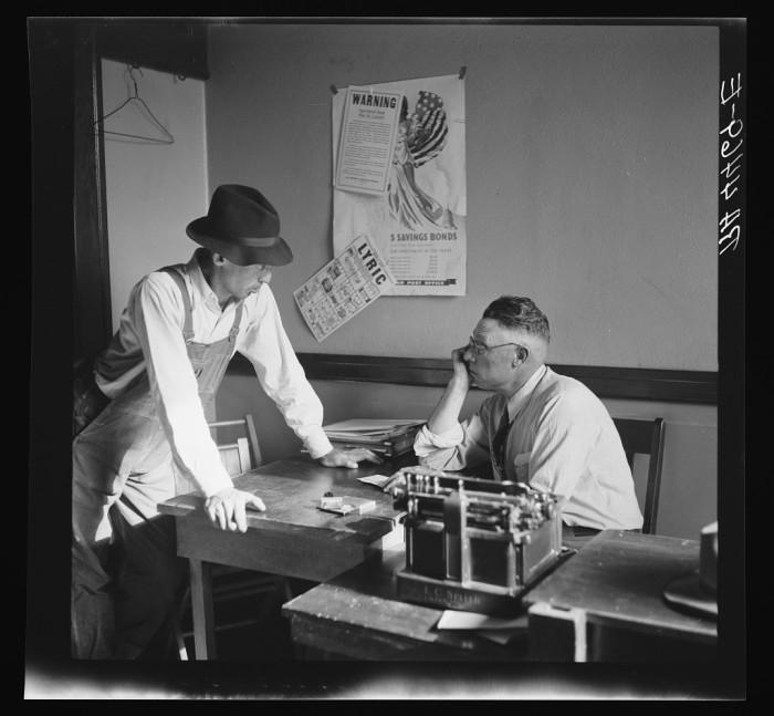 8. Men confer in a rehabilitation office.