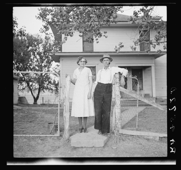 6. A farmer and his wife pose outside of their home in Custer County.