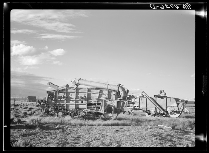 """12. """"Rusting and battered combines of more prosperous days show how vain efforts are to grow wheat in the dry central Oregon area"""""""