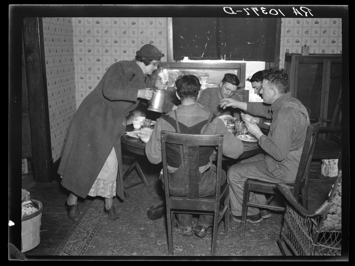 10. This is a man and his wife serving his neighbors lunch after they helped the move near Shadeland in 1937.