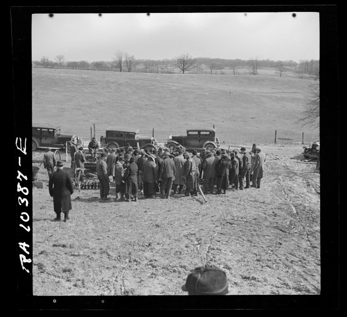 9. This is a cluster of farmers at a close out sale near Montmorenci in 1937.