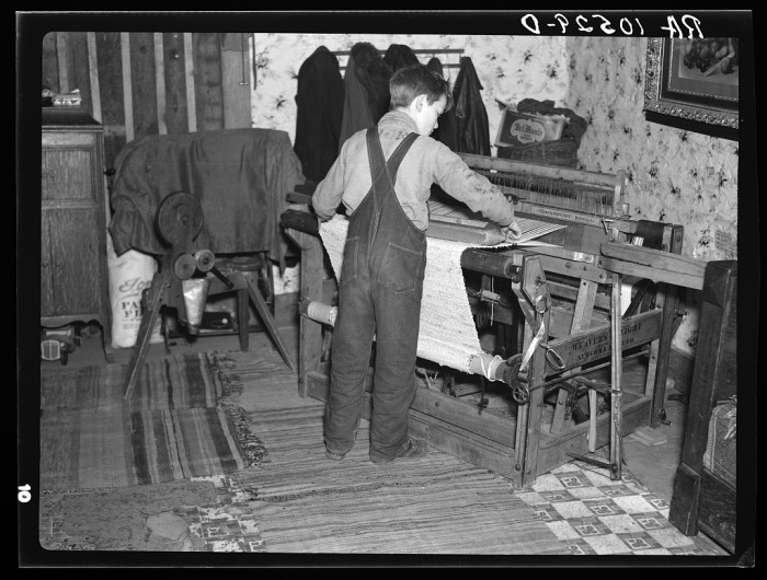 12. This child is weaving a rug for their farmhouse near Battle Ground, Indiana.
