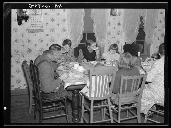 13. This is a family of 1937 sitting down to dinner in Fowler, Indiana.