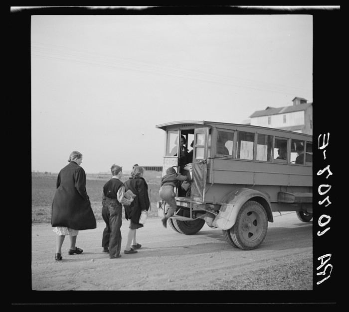 13. Here is a group of children getting on their school bus! Neat!