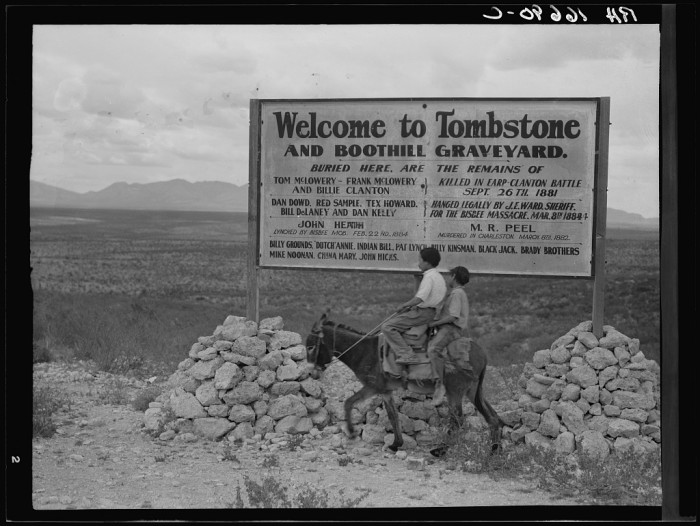 14. A couple of boys ride their donkey outside of Tombstone in 1937.