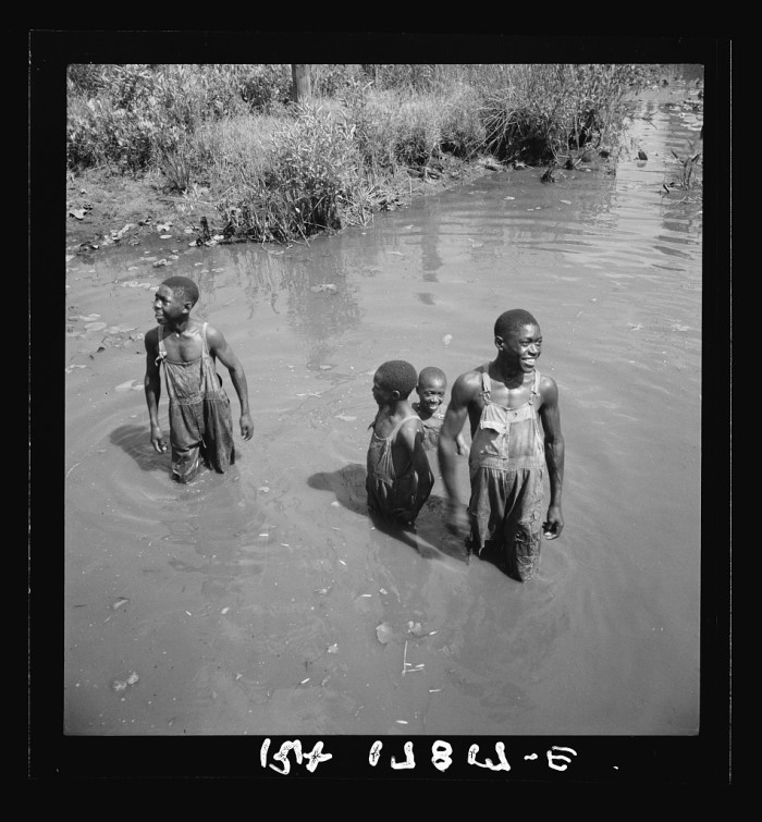 4. African American boys playing in a creek near Valdosta, GA. - July 1937