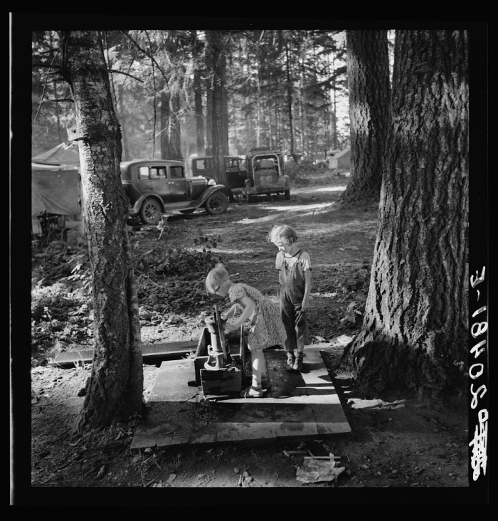 """21. """"Oregon, Marion County, near West Stayton. Children in large private bean pickers camp. Pickers came from many states, from Oklahoma to North Dakota"""""""
