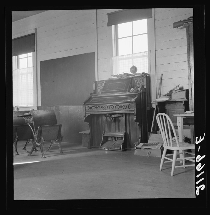"""6. """"8:45 a.m. Interior of the eastern Oregon one-room county school. Seven pupils enrolled. Between Pleasant Valley and Durkee, Baker County, Oregon."""""""