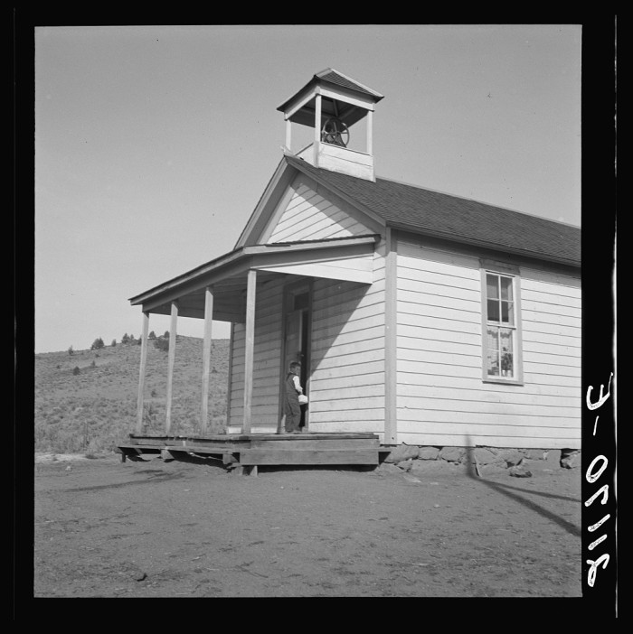"""8. """"Nine a.m. Four pupils attend this day, of the seven who are enrolled at the eastern Oregon county school. Between Pleasant Valley and Durkee, Baker County, Oregon."""""""