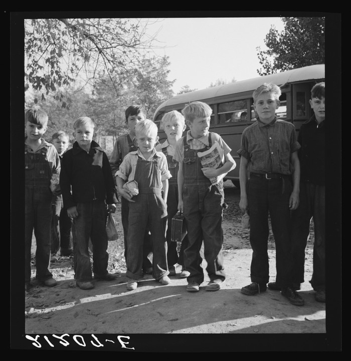 """1. """"The children from Dead Ox Flat get off bus at school yard. Ontario, Malheur County, Oregon."""""""