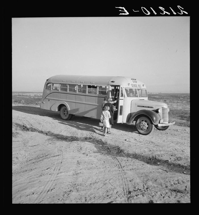 "5. ""Dead Ox Flat. Children get into school bus on a fall morning. Malheur County, Oregon. """