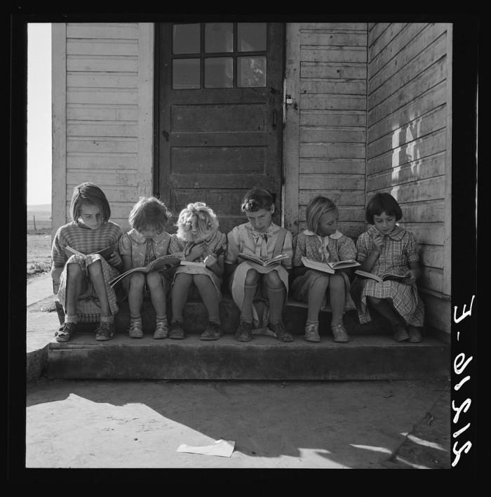 "9. ""Girls of Lincoln Bench School study their reading lesson. Near Ontario, Malheur County, Oregon."""