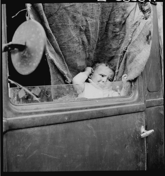 """17. """"Baby from Mississippi parked in truck at FSA (Farm Security Administration) camp, Merrill, Oregon."""""""