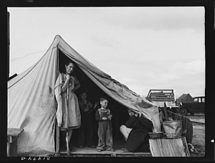 """24. """"This family came to the potato harvest after the Oregon hop harvest. In FSA (Farm Security Administration) camp unit. Merrill, Klamath County, Oregon"""""""