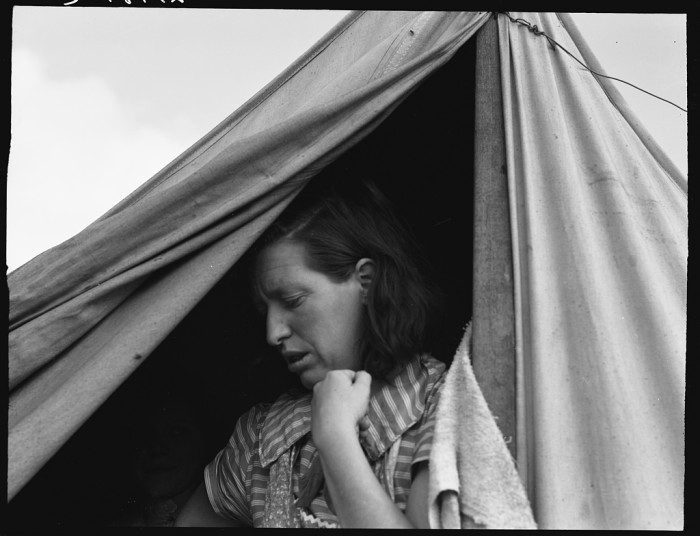 """9. """"'We made good money in the cherries this year. From then on we made just beans.' Merrill, Klamath County, Oregon. Woman in mobile unit of FSA (Farm Security Administration) camp"""""""