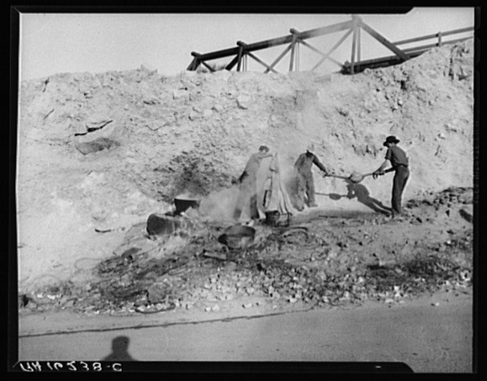 12. This photo shows some migrant Yuma cotton pickers boiling their cotton sacks before being allowed into California in 1937.