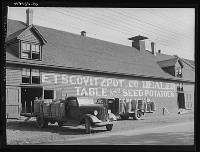 17. Potatoes being unloaded at one of the many track storage warehouses on the Bangor and Aroostook Railroad. (Fort Kent, 1940)