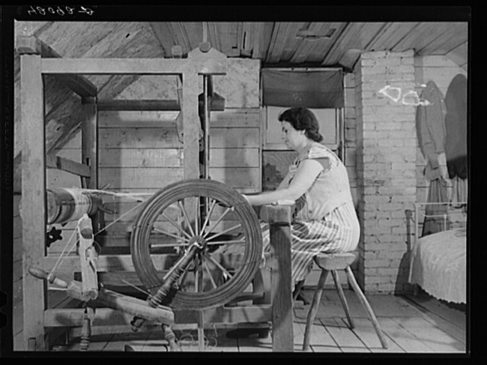 19. Farm Security Administration client, Mrs. Patrick Dumond, weaving toweling on a old loom in her attic. (Lille, 1940)