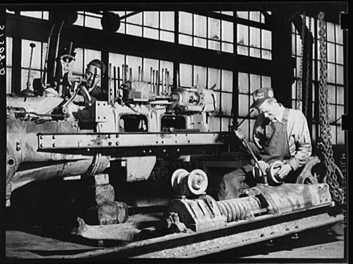 1. Two workers repairing a tractor at the FSA's warehouse depot in Atlanta, GA - May 1939