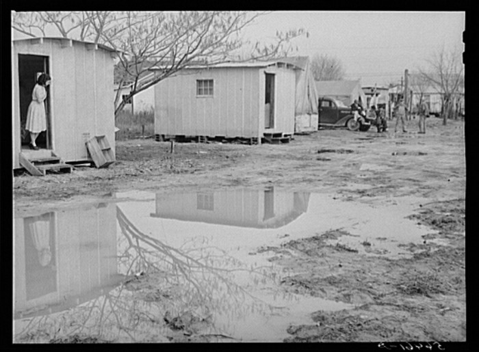 3. Metal shelters and tents of Army men and construction workers in Columbus, Georgia - December 1940