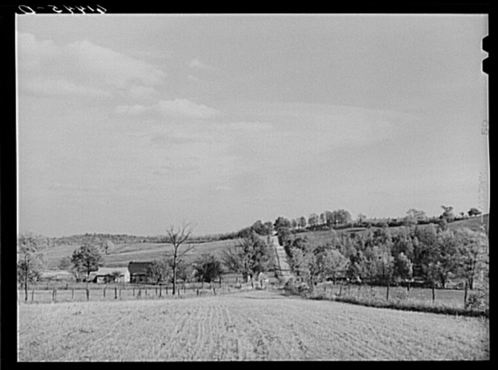 """8. """"At the foot of the hilly farm section of Ross County, Ohio. Town of Chillicothe in background."""""""