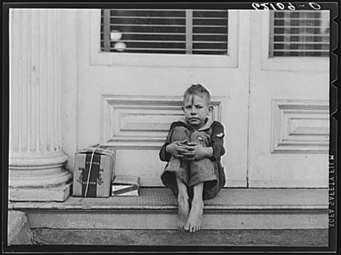 9. Little shoeshine boy in Columbus, Georgia - December 1940