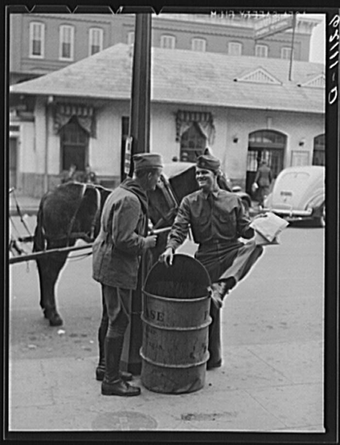 10. Soldiers talking on the corner in Columbus, Georgia - December 1940
