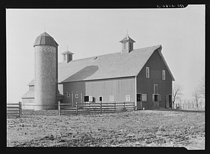 10. Here is an incredible shot of an old barn and silo from 1937.