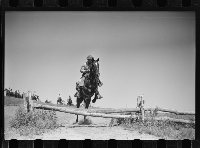"""2. """"Soldiers of a cavalry machine gun platoon going over an obstacle during a field problem."""""""