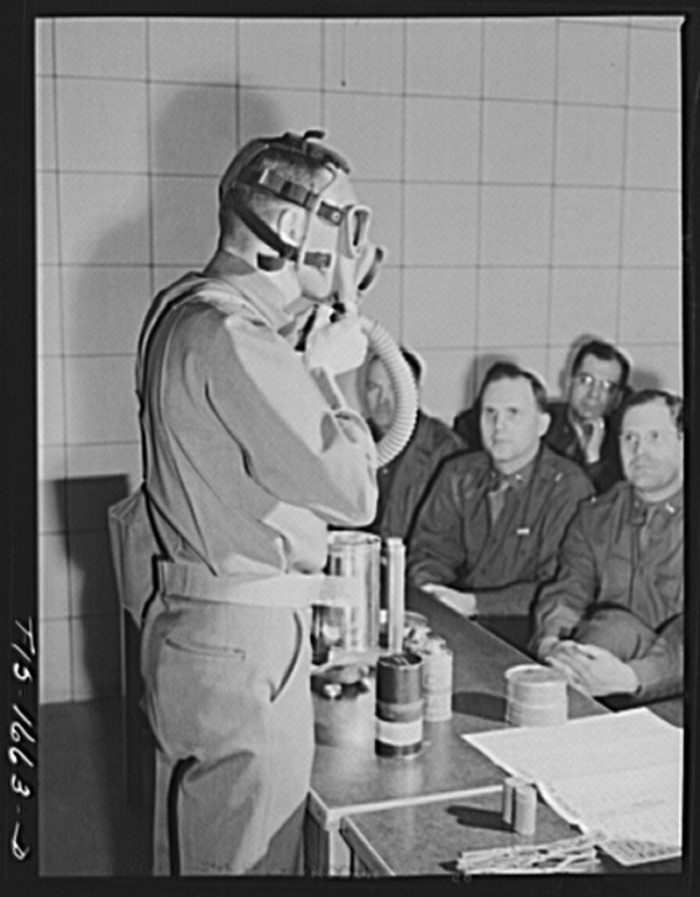 6. Here is Captain William W. Kitchen instructing a class on gas warfare.