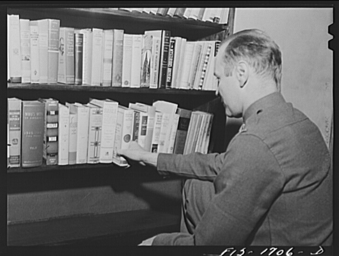 6. This is a recreation hall at the chaplain school in Indianapolis with a small library of books in 1942.