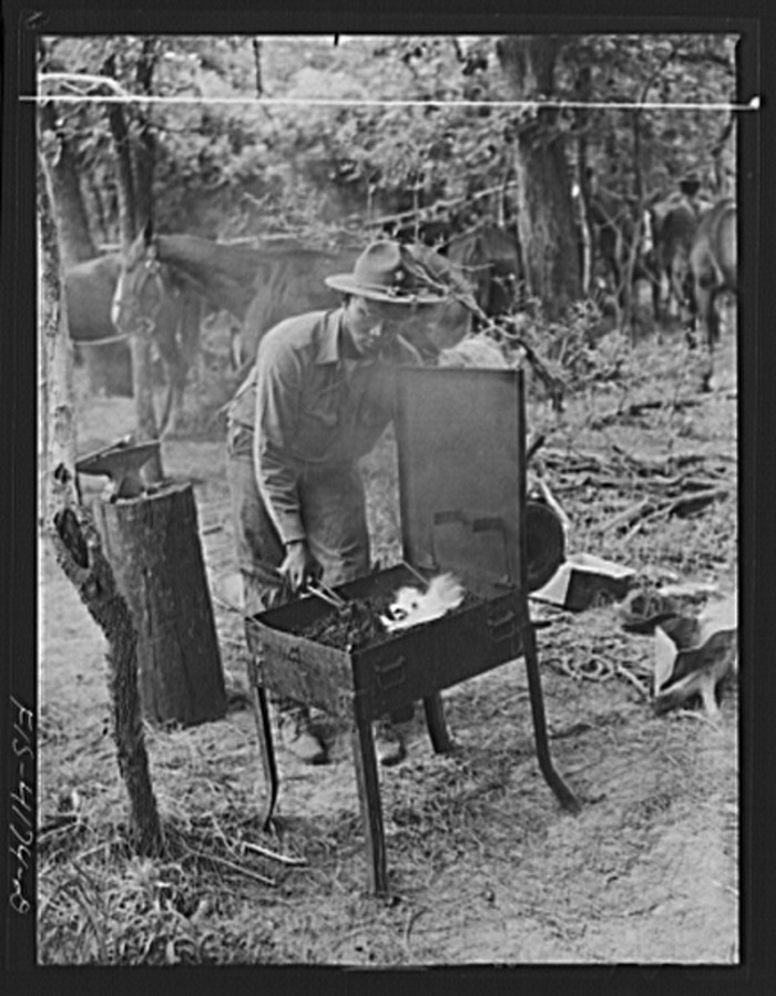 """8. """"Portable smithy being used during a field problem of the cavalry."""""""