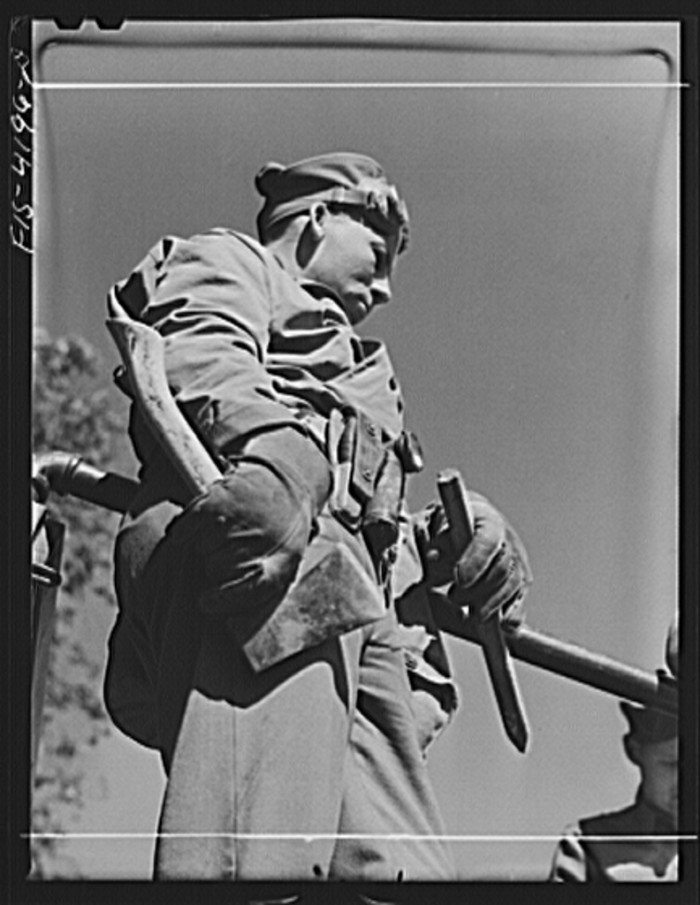 """10. """"A Signal Corps man attached to a truck unit."""""""