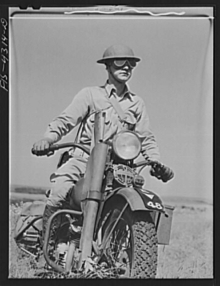 """14. """"Motorcyclist serving as a messenger for his platoon of the mechanized cavalry reconnaissance unit."""""""