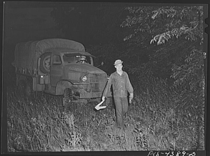 "18. ""Guiding a truck into bivouac area during a blackout."""
