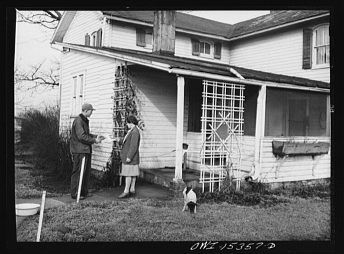 """14. """"Rio Grande, Ohio. Mr. and Mrs. Younkers, former Kentucky farmers, in front of their new home on Fred Bower's poultry farm."""""""