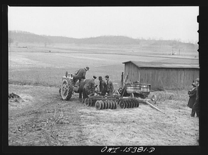 """15. """"Rio Grande, Gallia County, Ohio. Farm labor trainees attaching disc plow to tractor at the Rio Grande College."""""""