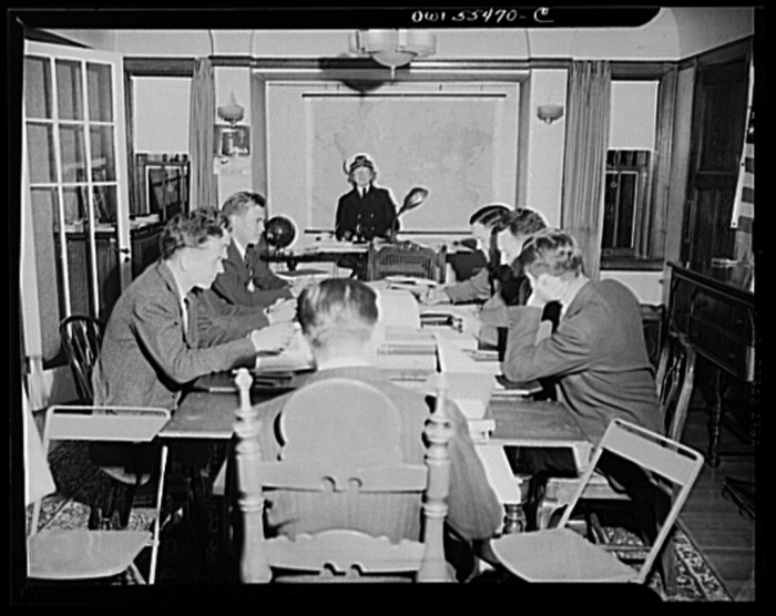 "1. ""'Captain' Mary Converse, instructing V-7 (candidates for United States Navy ensign commissions) students in use of sextant, compass and gyroscope and in navigation. Classes are held in dining room."""