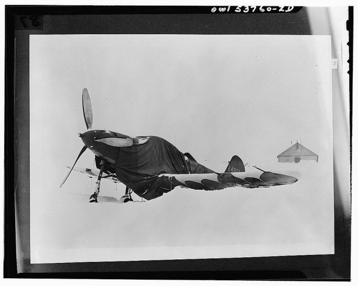 8) An Airacobra buried in snow.