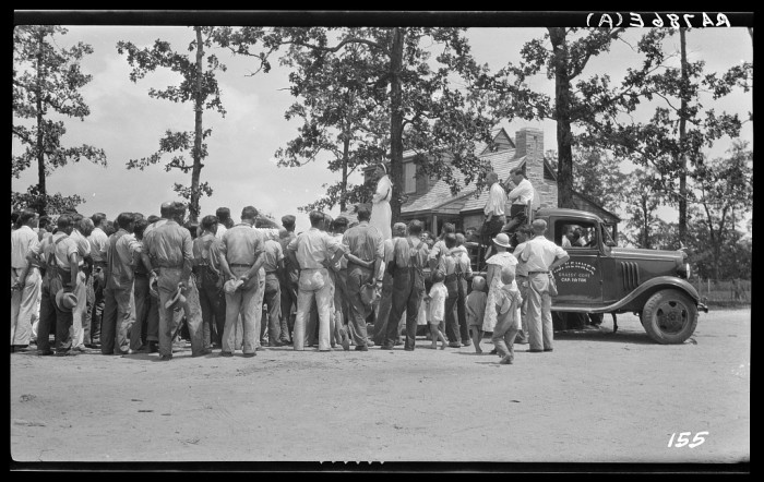 9) Mrs. Roosevelt giving her all to a group of men working on the Cumberland Homestead