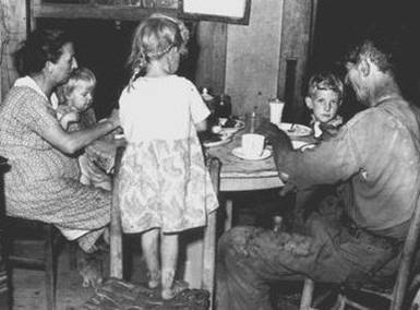 3. A  Straight Creek Coal Co. Miner and his family at dinner, 1945.