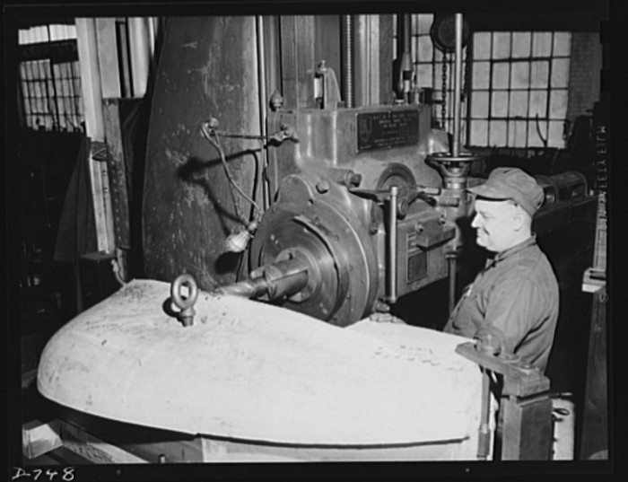 1. A boring mill machining a cast-iron die which, when finished, will be used to stamp out automobile fenders. Plant of Frederick Colman & Sons, Inc., Detroit, Michigan