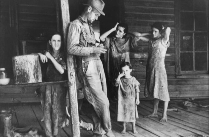 1. A family stands on their porch during the 1930s.