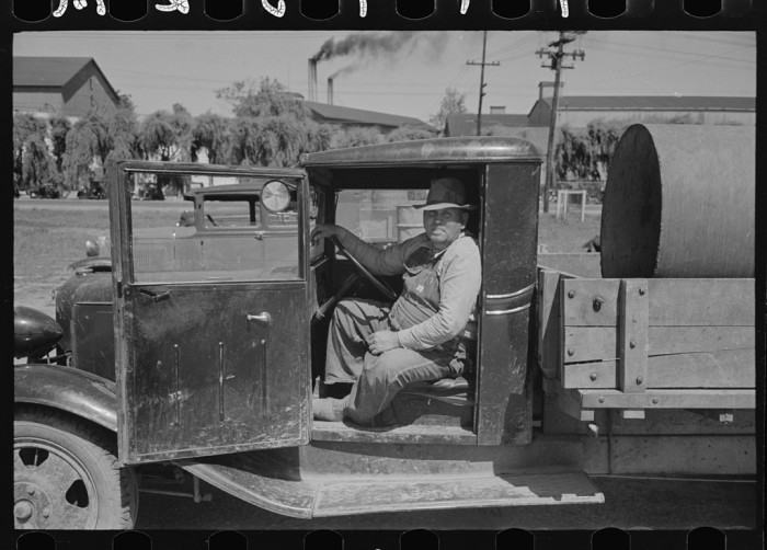 3. A farmer waiting in his truck to take care of business in the 1930s.