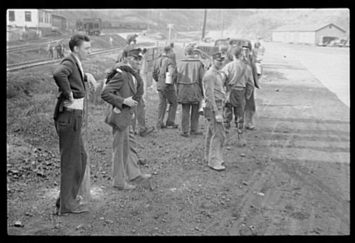 22. A group of coal miners waiting for their ride in Jenkins, 1935.